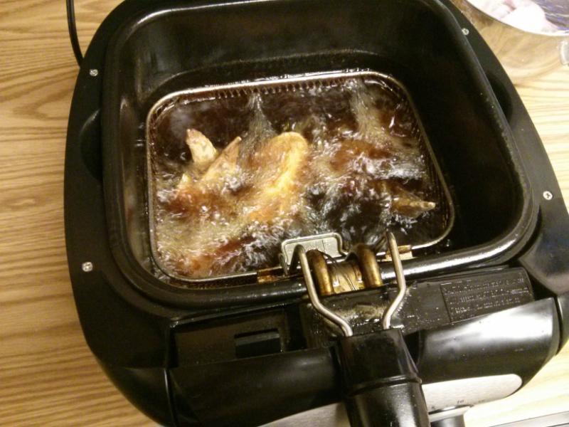 Fry wings until crispy