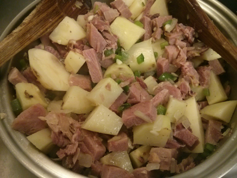 Ham, onion, potato mixture ready to be added to beans