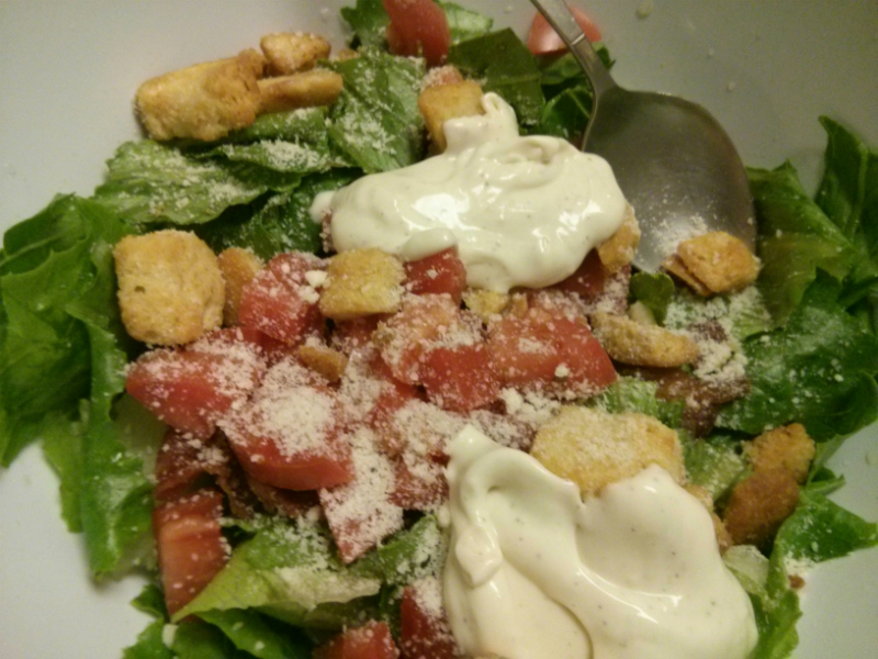BLT Caesar Salad ingredients in a bowl