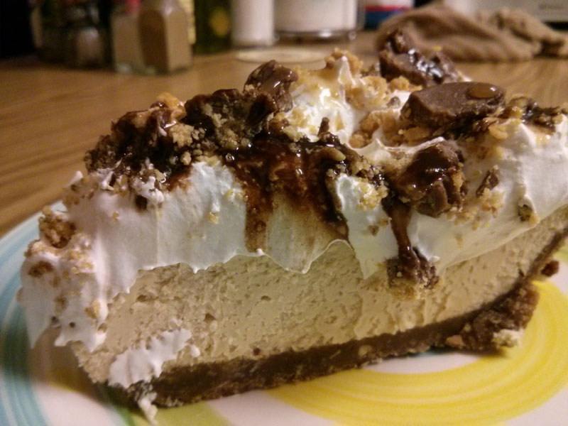 Large slice of Peanut Butter Chocolate Cheesecake
