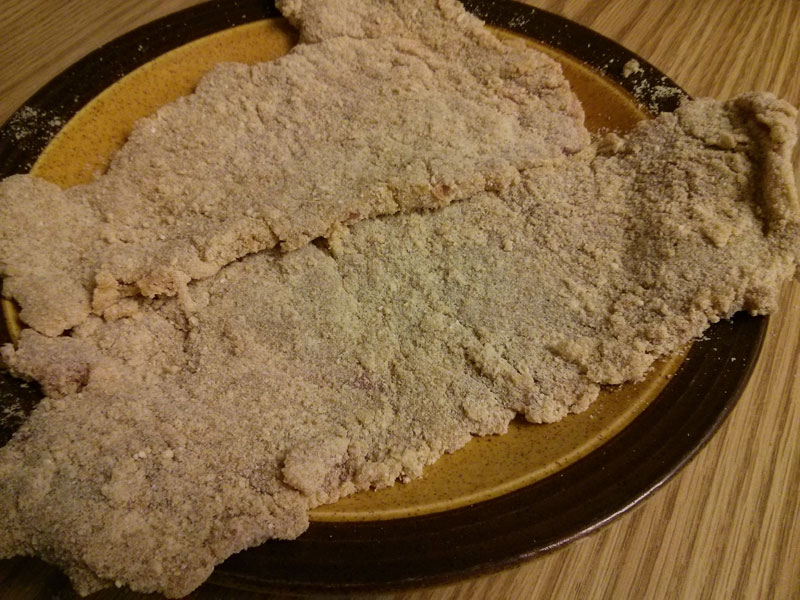 Breaded steak ready to be fried