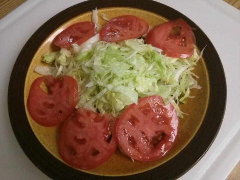 Shredded lettuce and sliced tomatoes
