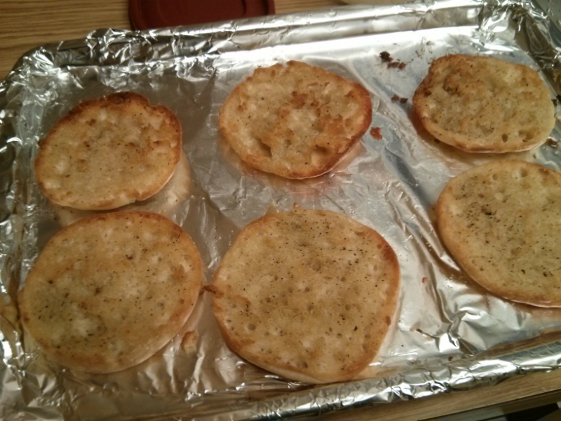 Toasted muffins ready to be sauced