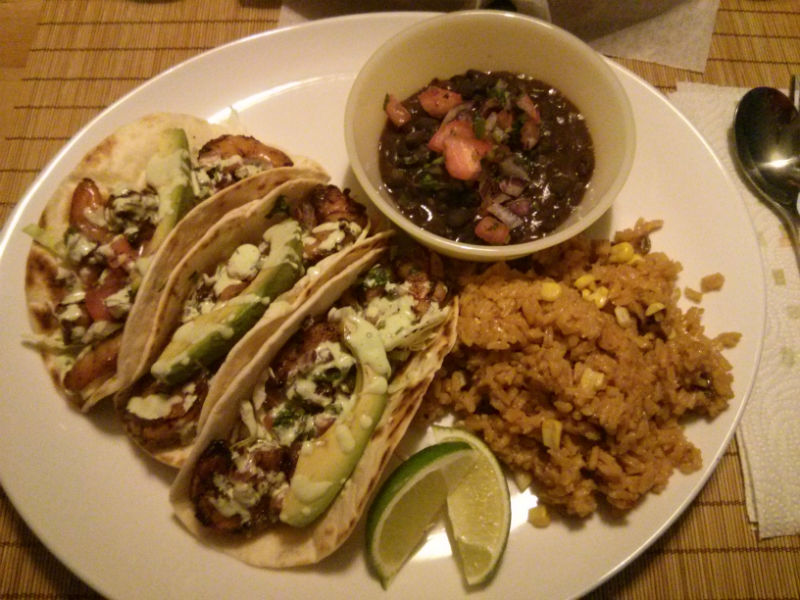 Spicy Grilled Shrimp Tacos served with rice and beans