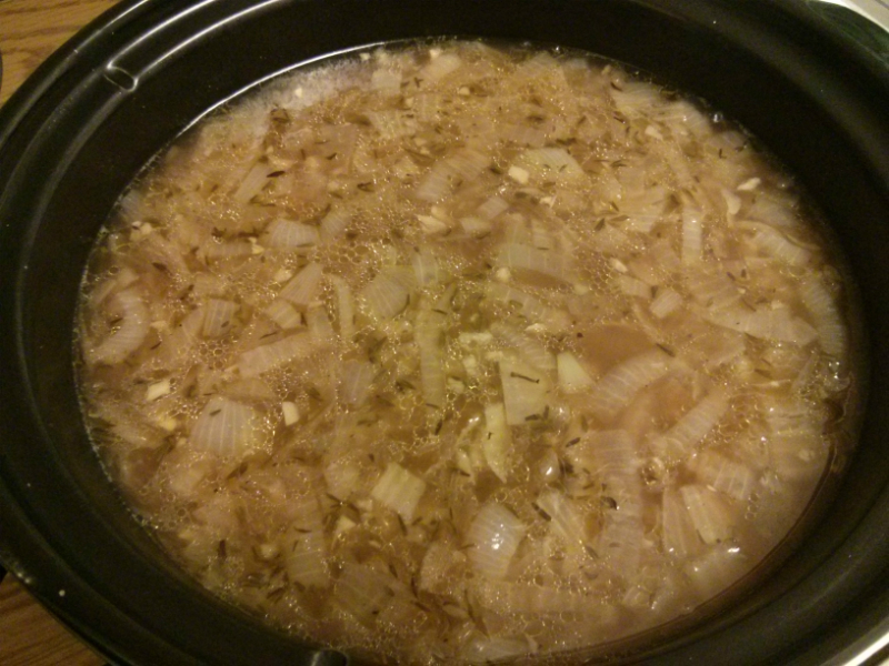 Transfer the onions to the slow cooker and add other ingredients.