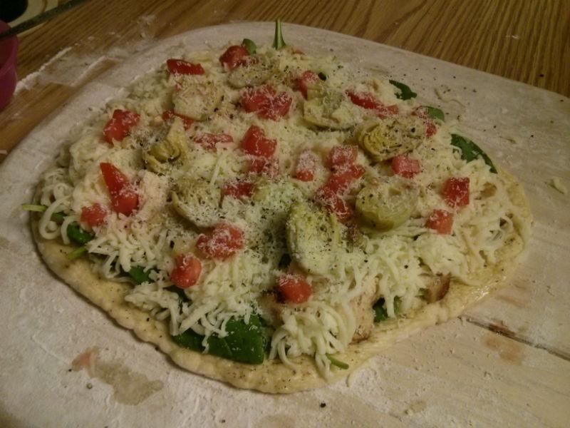Pollo e Formaggio (Chicken Spinach Tomato Artichoke and Cheese Pizza) ready for the oven