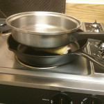 Place heavy pot or pan on top