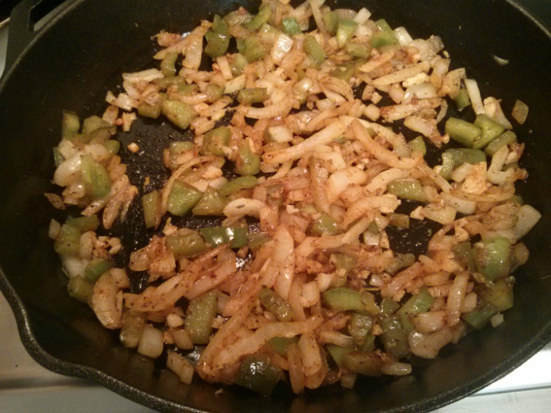 Green pepper onion sauteeing with spices