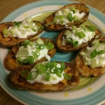 Top Potato Skins with sour cream and green onions. Serve immediately!